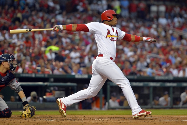 Aug 7, 2014; St. Louis, MO, USA;  St. Louis Cardinals right fielder Oscar Taveras (18) hits a RBI single against the Boston Red Sox during the first inning at Busch Stadium. Mandatory Credit: Jasen Vinlove-USA TODAY Sports