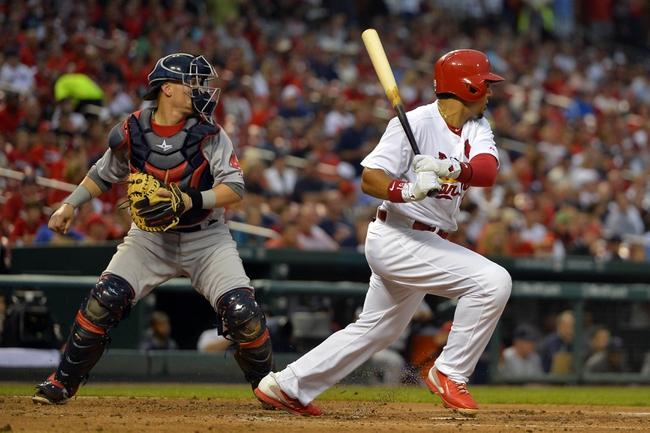 Aug 7, 2014; St. Louis, MO, USA;  St. Louis Cardinals center fielder Jon Jay (19) hits a single against the Boston Red Sox at Busch Stadium. Mandatory Credit: Jasen Vinlove-USA TODAY Sports