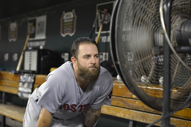 Aug 7, 2014; St. Louis, MO, USA;  Boston Red Sox first baseman Mike Napoli (12) cools off in the dugout between innings against the St. Louis Cardinals at Busch Stadium. Mandatory Credit: Jasen Vinlove-USA TODAY Sports