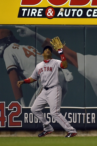 Aug 7, 2014; St. Louis, MO, USA;  Boston Red Sox left fielder Yoenis Cespedes (52) catches a fly ball for an out against the St. Louis Cardinals at Busch Stadium. Mandatory Credit: Jasen Vinlove-USA TODAY Sports