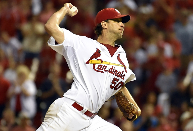 Aug 7, 2014; St. Louis, MO, USA;  St. Louis Cardinals starting pitcher Adam Wainwright (50) delivers a pitch against the Boston Red Sox at Busch Stadium. Mandatory Credit: Jasen Vinlove-USA TODAY Sports