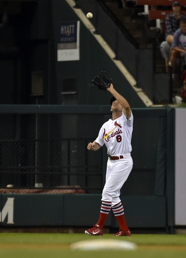 Aug 7, 2014; St. Louis, MO, USA;  St. Louis Cardinals center fielder Peter Bourjos (8) cathes a pop fly against the Boston Red Sox at Busch Stadium. Mandatory Credit: Jasen Vinlove-USA TODAY Sports