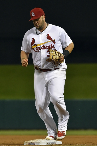 Aug 7, 2014; St. Louis, MO, USA;  St. Louis Cardinals first baseman Matt Adams (32) makes a put out at first base against the Boston Red Sox at Busch Stadium. Mandatory Credit: Jasen Vinlove-USA TODAY Sports