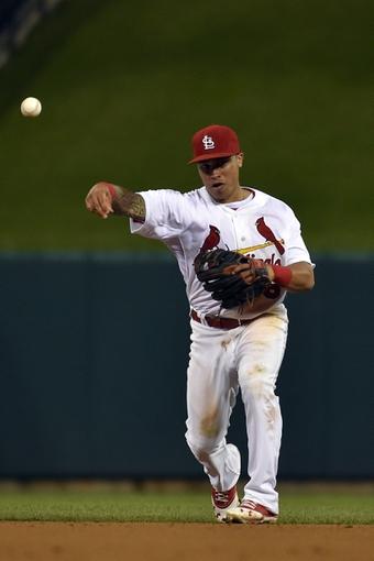 Aug 7, 2014; St. Louis, MO, USA;  St. Louis Cardinals second baseman Kolten Wong (16) throws out a Boston Red Sox base runner at Busch Stadium. Mandatory Credit: Jasen Vinlove-USA TODAY Sports