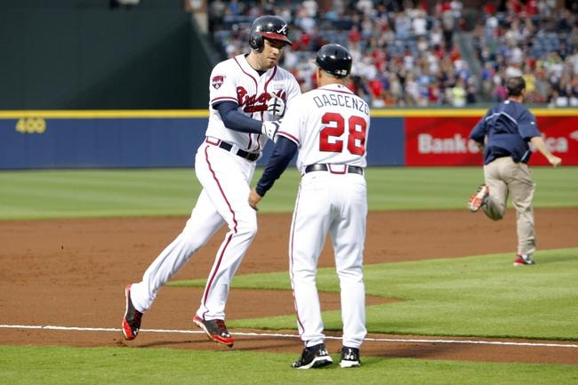 Aug 8, 2014; Atlanta, GA, USA; Atlanta Braves first baseman Freddie Freeman (5) is congratulated by third base coach Doug Dascenzo (28) after a home run against the Washington Nationals in the second inning at Turner Field. Mandatory Credit: Brett Davis-USA TODAY Sports