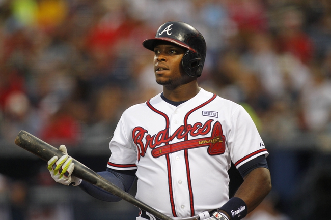 Aug 8, 2014; Atlanta, GA, USA; Atlanta Braves left fielder Justin Upton (8) bats against the Washington Nationals in the second inning at Turner Field. Mandatory Credit: Brett Davis-USA TODAY Sports