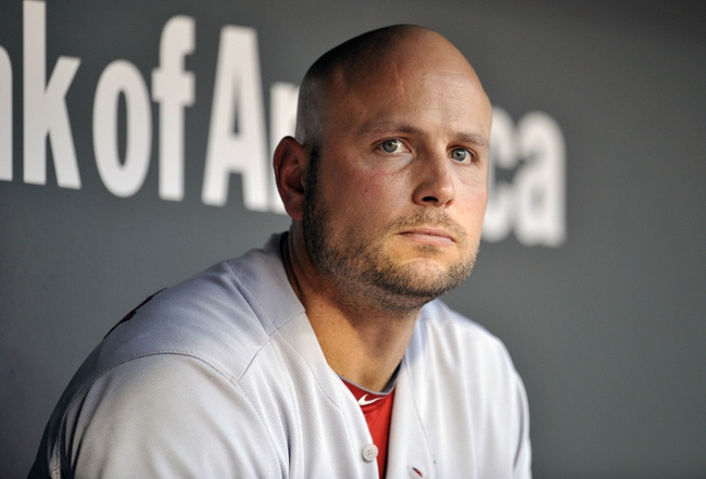 Aug 8, 2014; Baltimore, MD, USA; St. Louis Cardinals designated hitter Matt Holliday (7) looks on in the dugout against the Baltimore Orioles at Oriole Park at Camden Yards. Mandatory Credit: Joy R. Absalon-USA TODAY Sports
