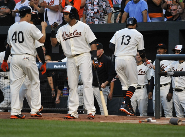 Aug 8, 2014; Baltimore, MD, USA; Baltimore Orioles third baseman Manny Machado (13) celebrates with teammates after hitting a three-run home run in the second inning against the St. Louis Cardinals at Oriole Park at Camden Yards. Mandatory Credit: Joy R. Absalon-USA TODAY Sports