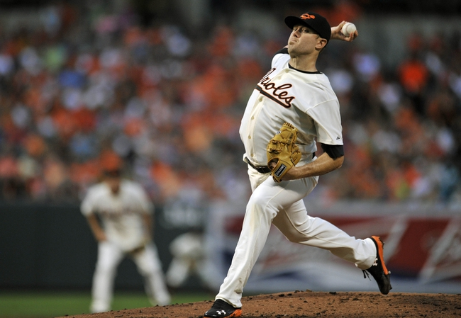 Aug 8, 2014; Baltimore, MD, USA; Baltimore Orioles starting pitcher Chris Tillman (30) pitches in the third inning against the St. Louis Cardinals at Oriole Park at Camden Yards. Mandatory Credit: Joy R. Absalon-USA TODAY Sports