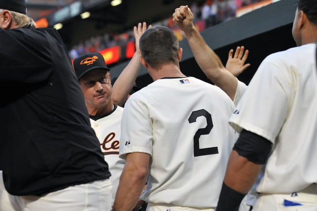 Aug 8, 2014; Baltimore, MD, USA; Baltimore Orioles shortstop J.J. Hardy (2) celebrates with teammates after hitting a solo home run in the third inning against the St. Louis Cardinals at Oriole Park at Camden Yards. Mandatory Credit: Joy R. Absalon-USA TODAY Sports