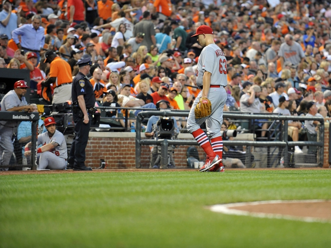 Aug 8, 2014; Baltimore, MD, USA; St. Louis Cardinals starting pitcher Justin Masterson (63) exits the game in the third inning against the Baltimore Orioles at Oriole Park at Camden Yards. Mandatory Credit: Joy R. Absalon-USA TODAY Sports