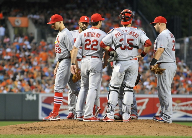 Aug 8, 2014; Baltimore, MD, USA; St. Louis Cardinals manager Mike Matheny (22) pulls starting pitcher Justin Masterson (63) in the third inning against the Baltimore Orioles at Oriole Park at Camden Yards. Mandatory Credit: Joy R. Absalon-USA TODAY Sports