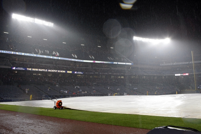 Aug 8, 2014; Atlanta, GA, USA; General view of the tarp covering the field during a rain delay during a game between the Atlanta Braves and Washington Nationals in the sixth inning at Turner Field. Mandatory Credit: Brett Davis-USA TODAY Sports