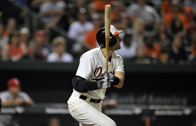 Aug 8, 2014; Baltimore, MD, USA; Baltimore Orioles second baseman Ryan Flaherty (3) hits a two-run home run in the sixth inning against the St. Louis Cardinals at Oriole Park at Camden Yards. The Orioles won 12-2. Mandatory Credit: Joy R. Absalon-USA TODAY Sports