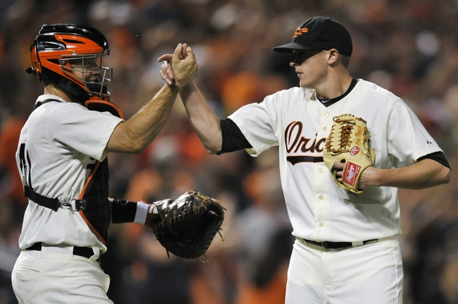 Aug 8, 2014; Baltimore, MD, USA; Baltimore Orioles pitcher Brad Brach (35) celebrates with catcher Nick Hundley (40) after their game against the St. Louis Cardinals at Oriole Park at Camden Yards. The Orioles won 12-2. Mandatory Credit: Joy R. Absalon-USA TODAY Sports
