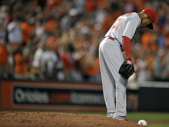 Aug 8, 2014; Baltimore, MD, USA; St. Louis Cardinals pitcher Sam Freeman (71) reacts after giving up a home run to Baltimore Orioles first baseman Chris Davis (not pictured) in the sixth inning at Oriole Park at Camden Yards. The Orioles won 12-2. Mandatory Credit: Joy R. Absalon-USA TODAY Sports