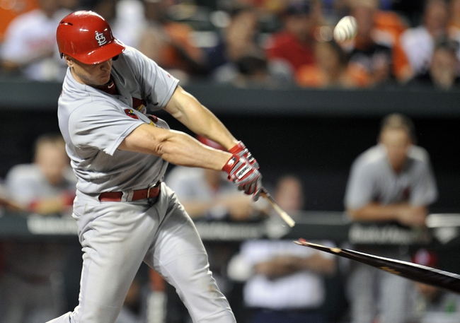Aug 8, 2014; Baltimore, MD, USA; St. Louis Cardinals first baseman Mark Ellis (3) breaks his bat in the seventh inning against the Baltimore Orioles at Oriole Park at Camden Yards. The Orioles won 12-2. Mandatory Credit: Joy R. Absalon-USA TODAY Sports