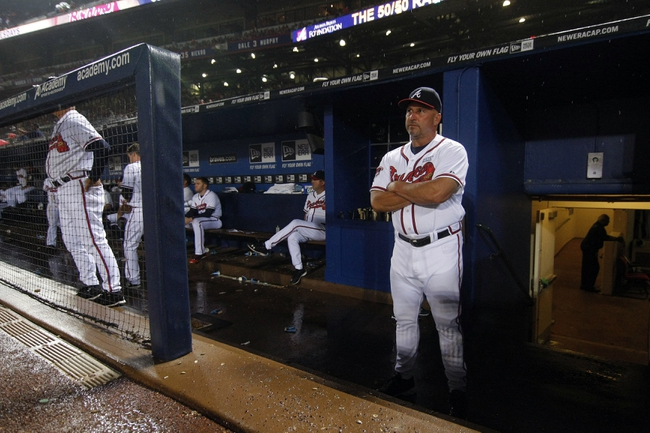 Aug 8, 2014; Atlanta, GA, USA; Atlanta Braves manager Fredi Gonzalez (33) in the dugout during a rain delay against the Washington Nationals in the sixth inning at Turner Field. Mandatory Credit: Brett Davis-USA TODAY Sports