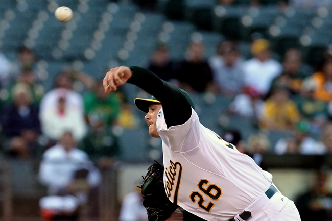 Aug 8, 2014; Oakland, CA, USA; Oakland Athletics starting pitcher Scott Kazmir (26) throws the ball against the Minnesota Twins in the first inning of their MLB baseball game at O.co Coliseum. Mandatory Credit: Lance Iversen-USA TODAY Sports