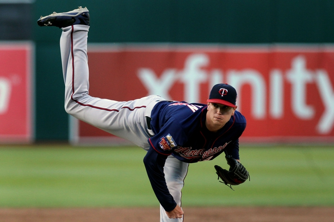 Aug 8, 2014; Oakland, CA, USA; Minnesota Twins starting pitcher Kyle Gibson (44) throws the ball against the Oakland Athletics in the first inning of their MLB baseball game at O.co Coliseum. Mandatory Credit: Lance Iversen-USA TODAY Sports