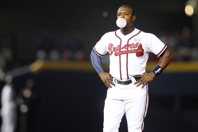 Aug 8, 2014; Atlanta, GA, USA; Atlanta Braves left fielder Justin Upton (8) blows a bubble between innings against the Washington Nationals in the seventh inning at Turner Field. Mandatory Credit: Brett Davis-USA TODAY Sports