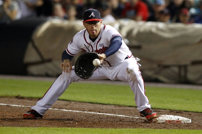 Aug 8, 2014; Atlanta, GA, USA; Atlanta Braves first baseman Freddie Freeman (5) catches a ball for an out at first against the Washington Nationals in the ninth inning at Turner Field. The Braves defeated the Nationals 7-6. Mandatory Credit: Brett Davis-USA TODAY Sports