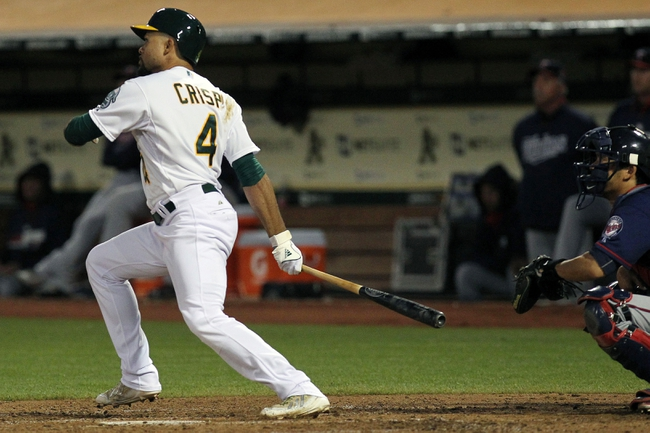 Aug 8, 2014; Oakland, CA, USA; Oakland Athletics DH Coco Crisp (4) hits a three run triple in the fifth inning against the Minnesota Twins at O.co Coliseum. Mandatory Credit: Lance Iversen-USA TODAY Sports