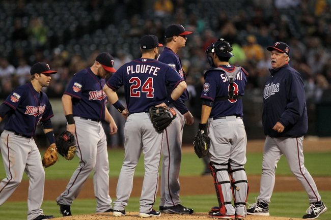 Aug 8, 2014; Oakland, CA, USA; Minnesota Twins starting pitcher Kyle Gibson (44) center has a discussion with teammates after the Oakland Athletics got three runners on base in the fifth inning at O.co Coliseum. Mandatory Credit: Lance Iversen-USA TODAY Sports