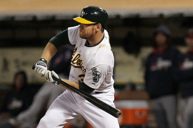 Aug 8, 2014; Oakland, CA, USA; Oakland Athletics left fielder Brandon Moss (37) holds up his swing on a wild pitch that scored A's DH Coco Crisp (not pictured) in the fifth inning against the Minnesota Twins at O.co Coliseum. Mandatory Credit: Lance Iversen-USA TODAY Sports
