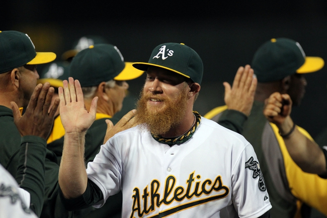 Aug 8, 2014; Oakland, CA, USA; Oakland Athletics closing pitcher Sean Doolittle (62) celebrates with teammates after defeating the Minnesota Twins 6-5 at O.co Coliseum. Mandatory Credit: Lance Iversen-USA TODAY Sports
