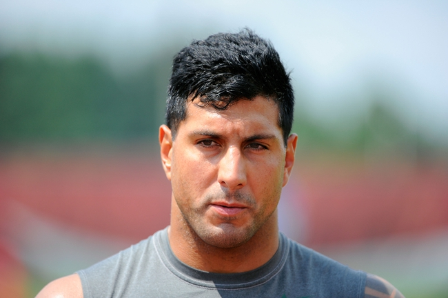 Aug 4, 2014; Cortland, NY, USA; New York Jets defensive end Jason Babin (58) walks to the locker room following training camp at SUNY Cortland. Mandatory Credit: Rich Barnes-USA TODAY Sports