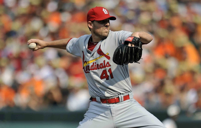 Aug 9, 2014; Baltimore, MD, USA; St. Louis Cardinals starting pitcher John Lackey (41) pitches in the first inning against the Baltimore Orioles at Oriole Park at Camden Yards. Mandatory Credit: Joy R. Absalon-USA TODAY Sports