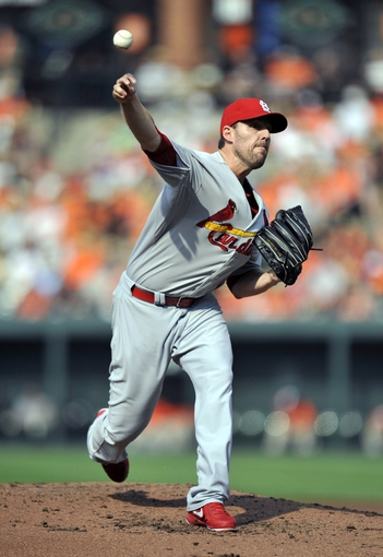 Aug 9, 2014; Baltimore, MD, USA; St. Louis Cardinals starting pitcher John Lackey (41) pitches in the second inning against the Baltimore Orioles at Oriole Park at Camden Yards. Mandatory Credit: Joy R. Absalon-USA TODAY Sports