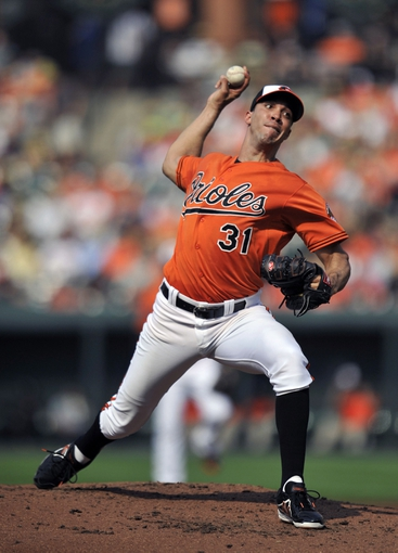 Aug 9, 2014; Baltimore, MD, USA; Baltimore Orioles starting pitcher Ubaldo Jimenez (31) pitches in the second inning against the St. Louis Cardinals at Oriole Park at Camden Yards. Mandatory Credit: Joy R. Absalon-USA TODAY Sports