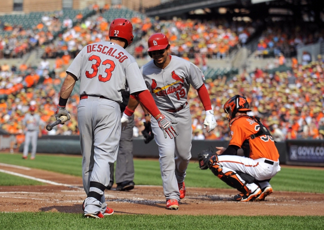 Aug 9, 2014; Baltimore, MD, USA; St. Louis Cardinals center fielder Jon Jay (19) is congratulated by Daniel Descalso (33) after hitting a solo home run in the second inning against the Baltimore Orioles at Oriole Park at Camden Yards. Mandatory Credit: Joy R. Absalon-USA TODAY Sports