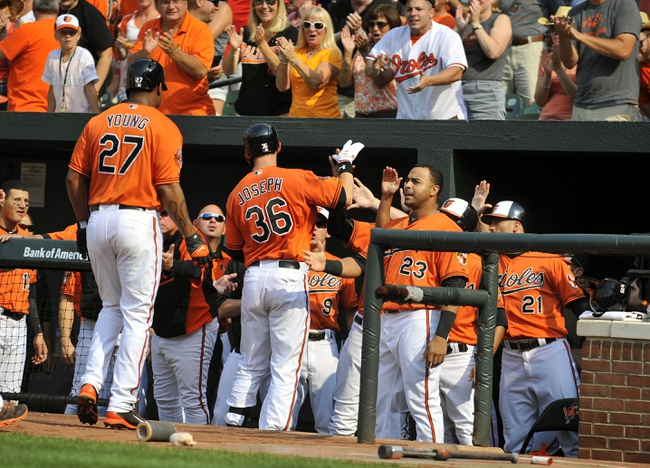 Aug 9, 2014; Baltimore, MD, USA; Baltimore Orioles catcher Caleb Joseph (36) is congratulated by teammates after hitting a two-run home run in the second inning against the St. Louis Cardinals at Oriole Park at Camden Yards. Mandatory Credit: Joy R. Absalon-USA TODAY Sports