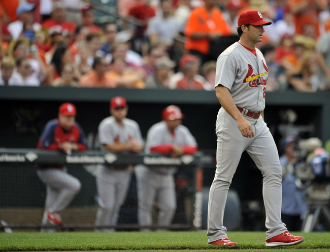 Aug 9, 2014; Baltimore, MD, USA; St. Louis Cardinals manager Mike Matheny (22) walks to the mound in the sixth inning against the Baltimore Orioles at Oriole Park at Camden Yards. The Orioles defeated the Cardinals 10-3. Mandatory Credit: Joy R. Absalon-USA TODAY Sports