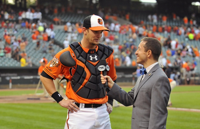 Aug 9, 2014; Baltimore, MD, USA; Baltimore Orioles catcher Caleb Joseph (36) is interviewed by Ken Rosenthal after a game against the St. Louis Cardinals at Oriole Park at Camden Yards. The Orioles defeated the Cardinals 10-3. Mandatory Credit: Joy R. Absalon-USA TODAY Sports