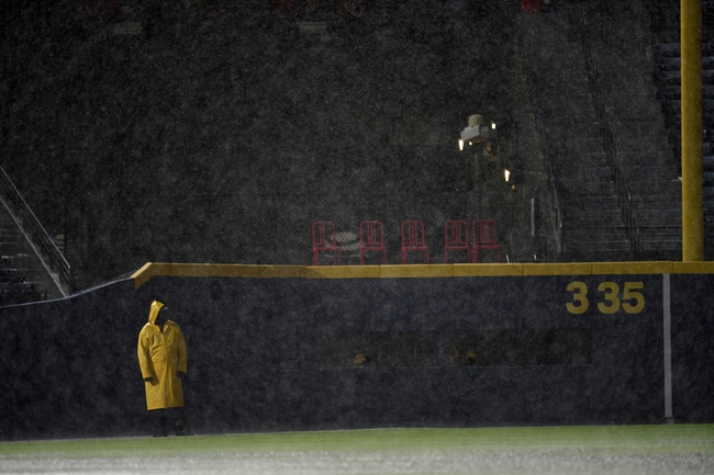 Aug 9, 2014; Atlanta, GA, USA; A security guard stands watch over the field in front of the visitors bullpen during a rain delay prior to the between the Washington Nationals and the Atlanta Braves at Turner Field. Mandatory Credit: Dale Zanine-USA TODAY Sports