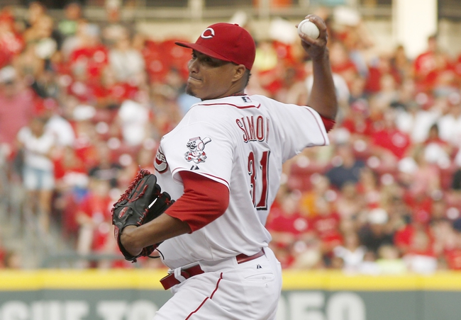 Aug 9, 2014; Cincinnati, OH, USA; Cincinnati Reds starting pitcher Alfredo Simon (31) throws against the Miami Marlins during the first inning at Great American Ball Park. Mandatory Credit: David Kohl-USA TODAY Sports