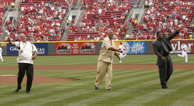 Aug 9, 2014; Cincinnati, OH, USA;  Cincinnati Reds former second baseman Ron Oester (left) , right fielder Dave Parker (middle) and center fielder Ken Griffey, Jr. (right) throw a ceremonial first pitch after they were inducted into the Reds Hall of Fame before a game between the Miami Marlins and the Cincinnati Reds at Great American Ball Park. Mandatory Credit: David Kohl-USA TODAY