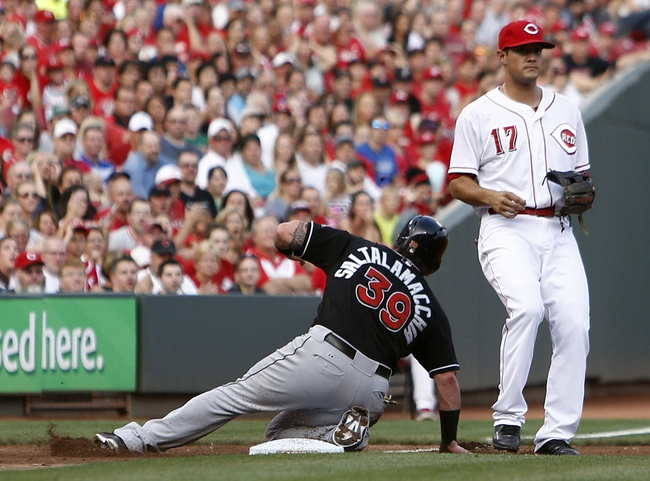 Aug 9, 2014; Cincinnati, OH, USA; Miami Marlins catcher Jarrod Saltalamacchia (39) slides safely into third past Cincinnati Reds third baseman Kris Negron (17) during the second inning at Great American Ball Park. Mandatory Credit: David Kohl-USA TODAY Sports