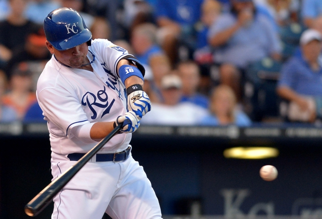Aug 9, 2014; Kansas City, MO, USA; Kansas City Royals designated hitter Billy Butler (16) hits a double in the seventh inning against the San Francisco Giants at Kauffman Stadium. Mandatory Credit: Denny Medley-USA TODAY Sports
