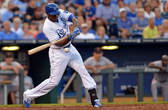 Aug 9, 2014; Kansas City, MO, USA; Kansas City Royals center fielder Lorenzo Cain (6) connects for a one run single in the seventh inning against the San Francisco Giants at Kauffman Stadium. Mandatory Credit: Denny Medley-USA TODAY Sports
