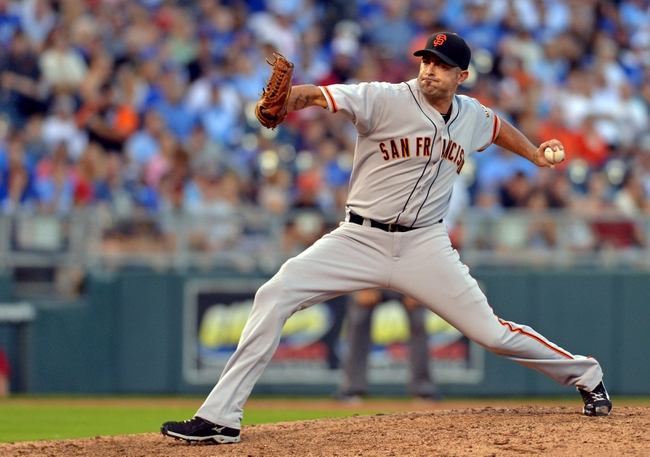 Aug 9, 2014; Kansas City, MO, USA; San Francisco Giants relief pitcher Jeremy Affeldt (41) delivers a pitch in the seventh inning against the Kansas City Royals at Kauffman Stadium. Mandatory Credit: Denny Medley-USA TODAY Sports