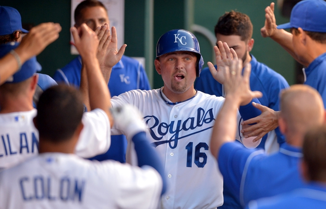 Aug 9, 2014; Kansas City, MO, USA; Kansas City Royals designated hitter Billy Butler (16) is congratulated by teammates in the dugout after scoring in the seventh inning against the San Francisco Giants at Kauffman Stadium. Mandatory Credit: Denny Medley-USA TODAY Sports