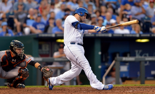 Aug 9, 2014; Kansas City, MO, USA; Kansas City Royals third baseman Mike Moustakas (8) connects for a one run single in the seventh inning against the San Francisco Giants at Kauffman Stadium. Mandatory Credit: Denny Medley-USA TODAY Sports