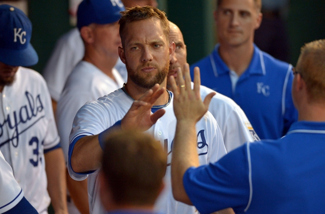 Aug 9, 2014; Kansas City, MO, USA; Kansas City Royals left fielder Alex Gordon (4) is congratulated by teammates after scoring in the seventh inning against the San Francisco Giants at Kauffman Stadium. Mandatory Credit: Denny Medley-USA TODAY Sports