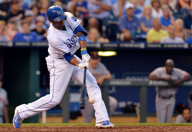 Aug 9, 2014; Kansas City, MO, USA; Kansas City Royals shortstop Alcides Escobar (2) connects for an RBI single in the seventh inning against the San Francisco Giants at Kauffman Stadium. Mandatory Credit: Denny Medley-USA TODAY Sports