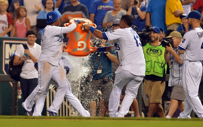 Aug 9, 2014; Kansas City, MO, USA; Kansas City Royals catcher Salvador Perez (13) and center fielder Jarrod Dyson (1) dump a cooler on starting pitcher James Shields (33) after the game against the San Francisco Giants at Kauffman Stadium. The Royals won 5-0. Mandatory Credit: Denny Medley-USA TODAY Sports